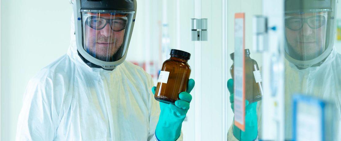 Lipids for BioNTech's Covid-19 vaccine: Chemist Mathias Günther with a bottled lipid batch in Evonik's lipid production in Hanau